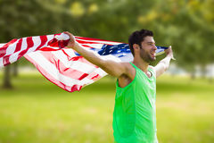 Composite image of happy sportsman holding a american flag Stock Photos