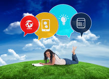 Composite image of happy student with speech bubbles Royalty Free Stock Image