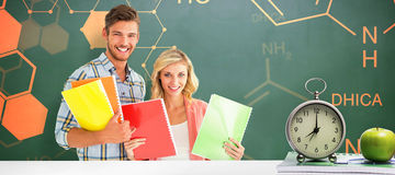 Composite image of happy students smiling at camera Royalty Free Stock Photo