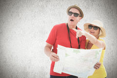 Composite image of happy tourist couple using map. Happy tourist couple using map against white background Royalty Free Stock Photos