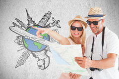 Composite image of happy tourist couple using map and pointing Royalty Free Stock Photos
