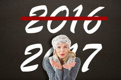 Composite image of happy winter blonde royalty free stock images