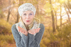 Composite image of happy winter blonde Stock Image