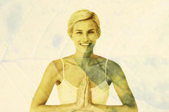 Composite image of happy woman doing yoga smiling at camera Royalty Free Stock Photography