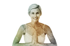 Composite image of happy woman doing yoga smiling at camera Stock Photos