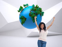 Composite image of a happy woman with her hands in the air Stock Images