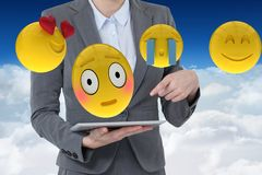 Composite image of happy woman with smileys Stock Photos