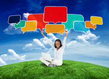 Composite image of happy woman with speech bubbles Stock Images