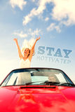 Composite image of happy woman standing in cabriolet while her boyfriend driving Stock Photo