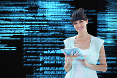 Composite image of happy woman using tablet Royalty Free Stock Images