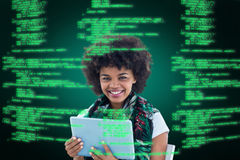 Composite image of happy woman using tablet Royalty Free Stock Photography