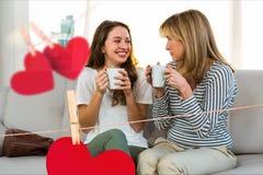 Composite image of happy women holding coffee mug Stock Photo