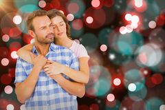 Composite image of happy young couple embracing Stock Photo
