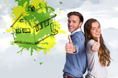 Composite image of happy young couple gesturing thumbs up Stock Photography
