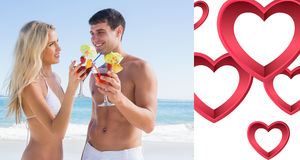 Composite image of happy young couple holding cocktails Royalty Free Stock Photography