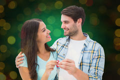Composite image of happy young couple holding new house key Stock Photos