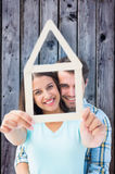 Composite image of happy young couple with house shape Royalty Free Stock Photography