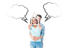 Composite image of happy young couple with house shape Stock Photos