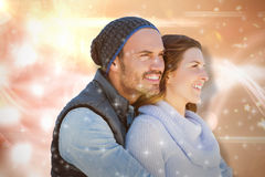 Composite image of happy young couple looking away. Happy young couple looking away against glowing background Stock Photography