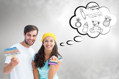 Composite image of happy young couple painting together Royalty Free Stock Photo