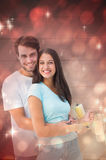 Composite image of happy young couple painting together Stock Images