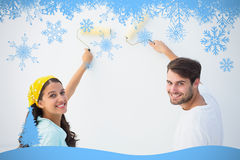 Composite image of happy young couple painting together Stock Image
