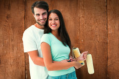 Composite image of happy young couple painting together Royalty Free Stock Image