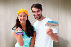 Composite image of happy young couple painting together Stock Photography