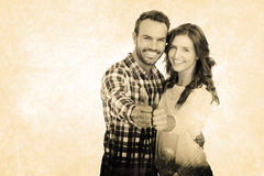Composite image of happy young couple putting thumbs up Royalty Free Stock Image