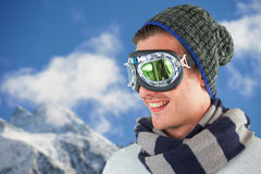 Composite image of happy young man wearing aviator goggles against white background stock images