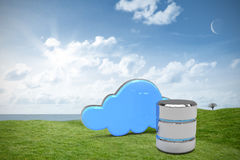 Composite image of hard drive symbol with cloud. Hard drive symbol with cloud against green field under blue sky Royalty Free Stock Photography