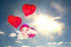 Composite image of heart balloons Stock Photos
