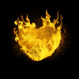 Composite image of heart in fire. Heart in fire against black Stock Photography