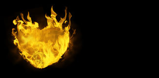 Composite image of heart in fire. Heart in fire against black Stock Image