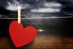 Composite image of heart hanging on line Stock Photography