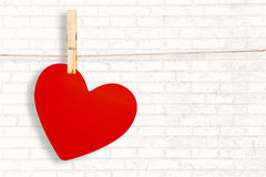 Composite image of heart hanging on line Stock Photo
