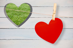 Composite image of heart hanging on line Stock Images