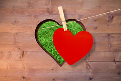 Composite image of heart hanging on line Stock Image