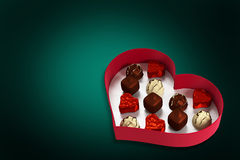 Composite image of heart shaped box of candy Royalty Free Stock Photos