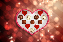Composite image of heart shaped box of candy Stock Images