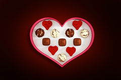 Composite image of heart shaped box of candy Stock Photo