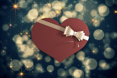 Composite image of heart shaped box of candy Stock Image
