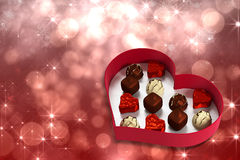 Composite image of heart shaped box of candy Royalty Free Stock Image