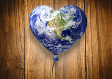 Composite image of heart shaped earth Royalty Free Stock Image