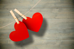 Composite image of hearts hanging on line Royalty Free Stock Images