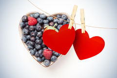 Composite image of hearts hanging on line Stock Photo