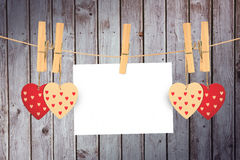 Composite image of hearts hanging on the line Stock Image