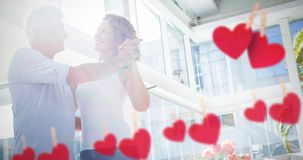 Composite image of hearts hanging on a line Stock Images