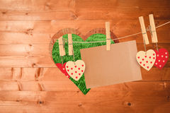 Composite image of hearts hanging on line with card Stock Photos