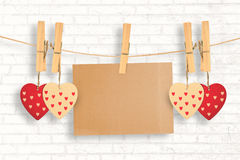 Composite image of hearts hanging on line with card Royalty Free Stock Photography